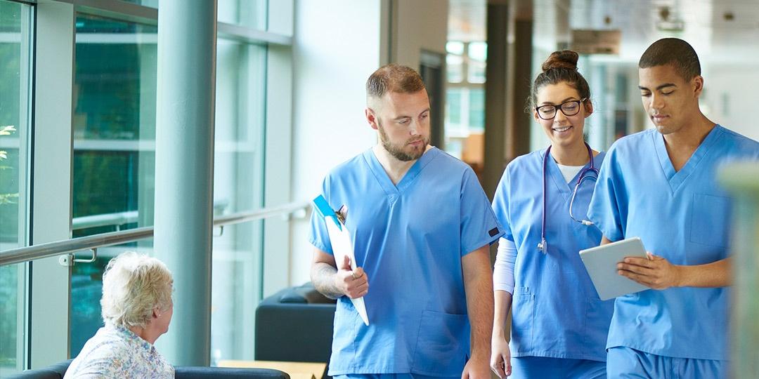 Asian nurses shaving male patients